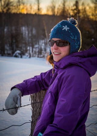 winter escape: Snowshoeing Woman in Winter Outdoors at Sunset