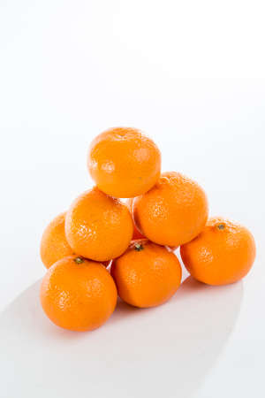 clementine fruit: Bright Orange Clementines on a bright background Stock Photo