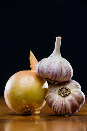 asian flavors: Onion Garlic and Ginger on Dark Background