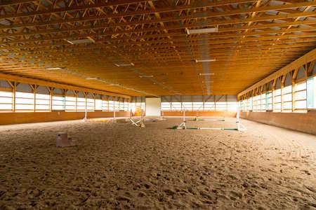 jumper: indoor sand ring for hunter jumper riding
