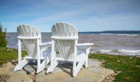waters  edge: Muskoka Chairs by the waters edge for scenic view
