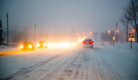 driving conditions: Driving an Icy Winter Roadway Stock Photo