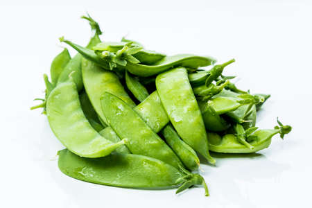 sweet sugar snap: Fresh Green Sugar Snap Peas on a Bright Background