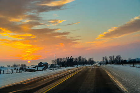 sub zero: Driving an Icy Winter Roadway Stock Photo