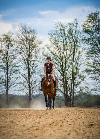 jumper: Woman Practicing on Hunter Jumper Horse in Ring
