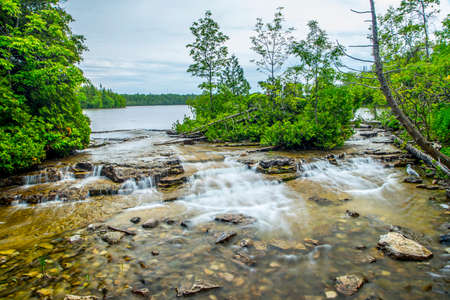 long lake: small flowing waterfalls in nature landscape