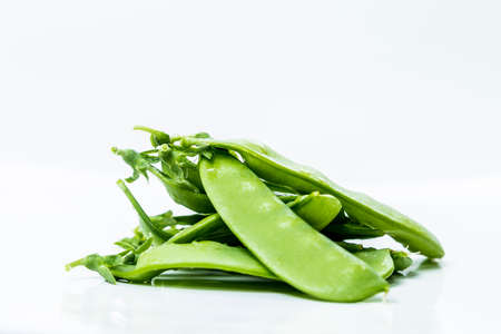Fresh Green Sugar Snap Peas on a Bright Background
