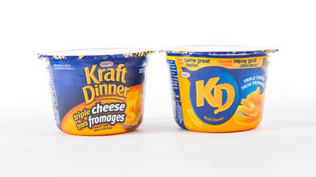 illustrative editorial: TORONTO, CANADA - FEBRUARY 9, 2016 : Kraft Dinner Macaroni and Cheese Personal Portions in an illustrative editorial on bright background Editorial