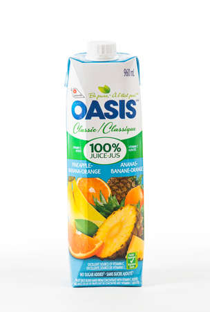 illustrative editorial: TORONTO, CANADA - FEBRUARY 9, 2016 : Oasis Brand of Fruit Juice Tetra Pack in an illustrative editorial on bright background