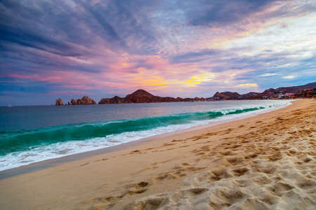 sunrise ocean: View of Waves at Sandy Beach of Cabo San Lucas in Mexico