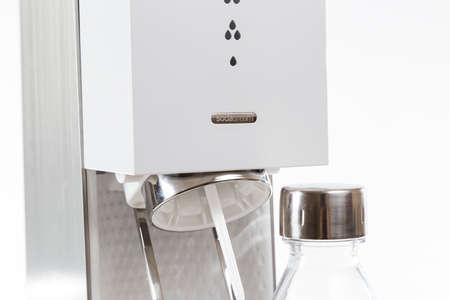 carbonation: TORONTO, CANADA - FEBRUARY 9, 2016 : Sodastream Source brand of home Water Carbonation Unit in an illustrative editorial on bright background