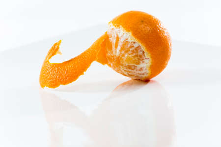 rinds: Closeup on Orange Clementines in Bright Studio Stock Photo
