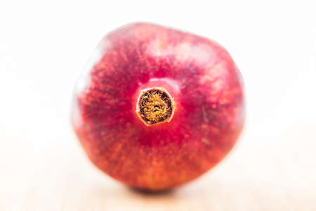 pommegranate: Closeup of Fresh Fruit in Bright Studio with a shallow depth of field. Stock Photo