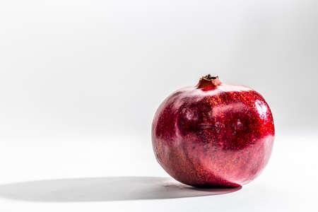 Pomegranate on bright background