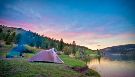 camping tent: tent camper set up in wilderness