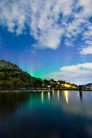 british weather: northern lights on mountain lake