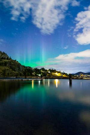 northern light: northern lights on mountain lake