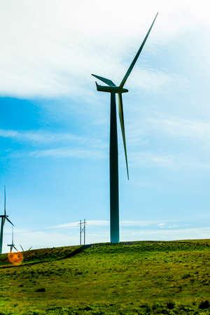 windy energy: wind turbine silhouette on the landscape Stock Photo