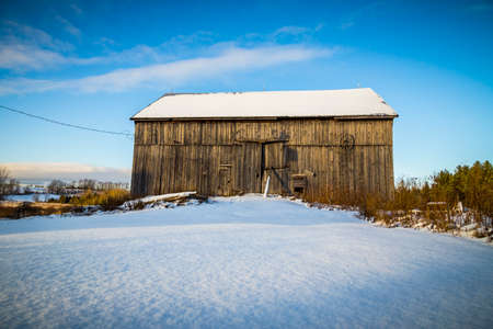 old barn in winter: rustic old barn Stock Photo