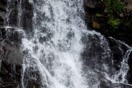 closeup view of water cascading down rocks