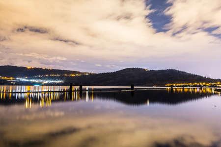 山の中の町は夜ライトアップ 写真素材