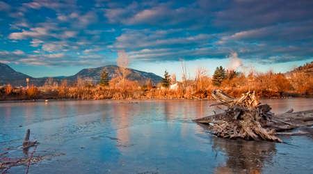 frozen pond in mountain winter landscape