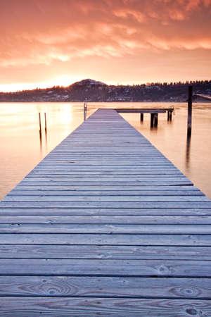 vibrant cottage: scenic sunset on mountain lake