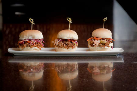 pulled: plate of pulled pork mini burgers