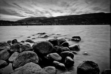 scenic view of mountain lake in black and white