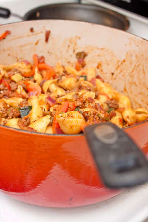 homestyle: cooking pasta and tomato sauce at home Stock Photo