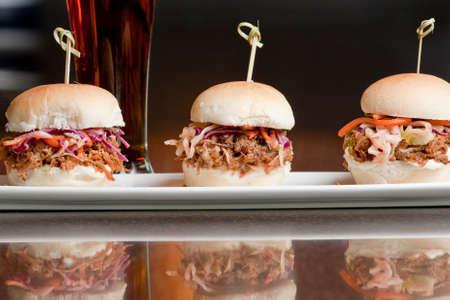 plate of pulled pork mini burgers