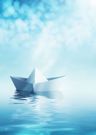 toy boat: Paper boat on azure water Stock Photo