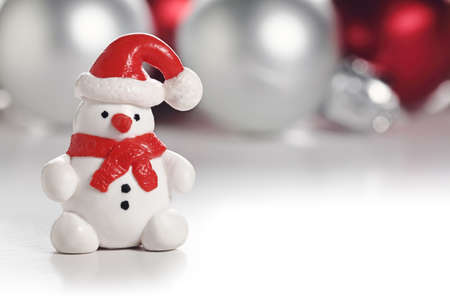 christmass: Snowman with Santa hat. Christmas greeting card with copy space
