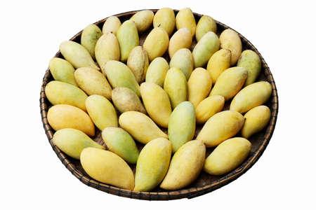 Piles of mango ripe yellow gold in the threshing basket on white background Stock Photo
