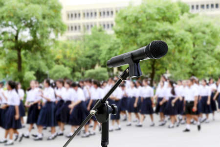Microphone close up shot on Blurred Students high school walking for Background