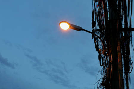 Street lights mounted on poles at evening time
