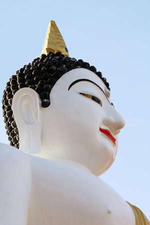 Buddha Statue White on sky background Stock Photo