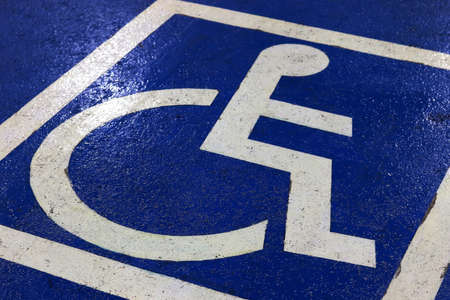 Parking symbol for the disabled in the car park (Selective Focus)