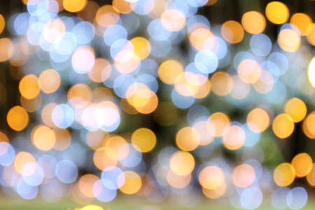 Bokeh background gold yellow colorful of merry christmas, Happy new year bokeh lighting shine on night background, Bokeh glitter light, Gold Luxury backdrop texture, Glittering wallpaper