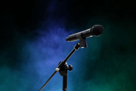 Microphone close up in dark night smoke background (selective focus)
