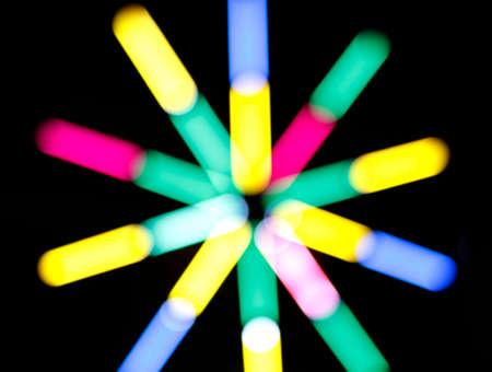 blur colors light beam of fluorescent light colorful in dark for festival temple fair background, lighting beam in carnival colorful light shine show of thai temple fair festival color bokeh beautiful Reklamní fotografie