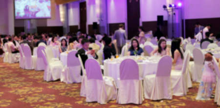 blurred wedding dining party in hall room for background, wedding celebration dinner blur image