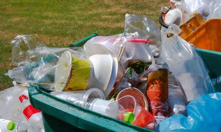 garbage waste plastic on trash, lots of plastic waste on the bin, pollution waste