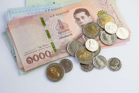 money banknote thai baht on white background, savings money and financial business concept, copy space