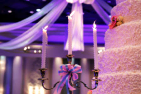 Blurred image for wedding background, Candle holders and wedding cake decorative in wedding celebration event for background
