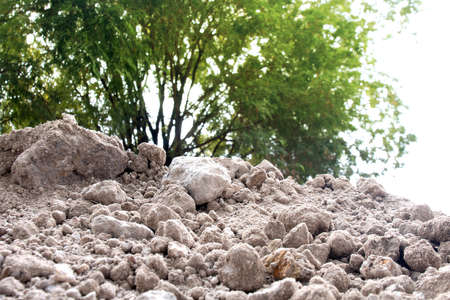 soil pile, dirt hill for agriculture and construction building site, soil mound dirt white