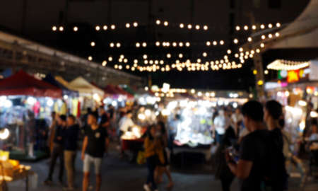 blurred night life people on street market for background, walking street market blur image, outdoor market night in shopping holiday and travel