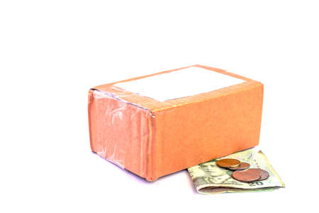 parcel post box and money banknote thai baht on white, money and cardboard box for shipping service concept, carton box packing and banknote for purchase sell concept Stok Fotoğraf