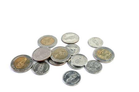 pile of thai baht coins, money medal of thailand on white
