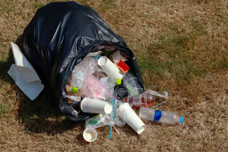 bag plastic and plastic waste on the grass, black plastic bag and garbage waste on floor, plastic pollution, copy space